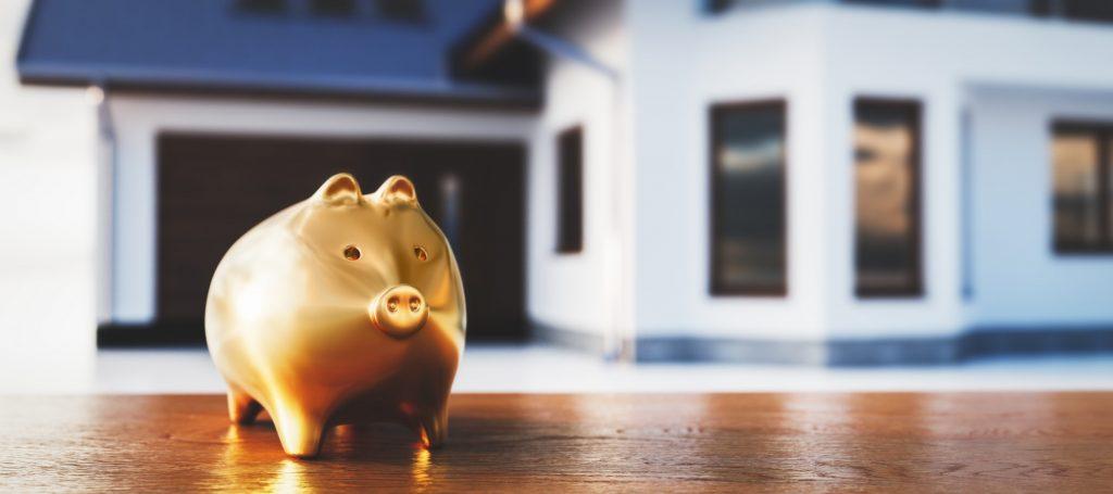 Piggybank and new house, saving for home, mortgage.